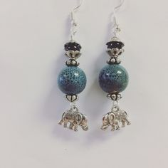 Cute blue speckled earrings with elephant accents by EcclecticSouls on Etsy