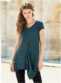 A sculptural panel drapes gracefully on one side of our tweeded tile blue tunic, underscoring its cool, contemporary design. Fine gauge knit in a lightweight blend of pima (76%) and nylon (24%) flamé yarns, with center seaming and curved side slits.
