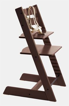 Stokke Tripp Trapp highchair in walnut brown. Came to this after trying a the Phil MeToo lobster (clip-on) chair and the IKEA Blåmes. Totally wish I'd tried this one first. Unfortunately, the baby set and playtray have to be purchased separately.
