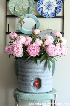 Love these gorgeous pink peonies in a vintage galvanized water cooler eclecticallyvintage.com