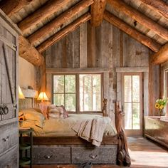 Cabin bedroom with high vaulted ceiling. love the  patina from the  the old  repurposed barn wood.
