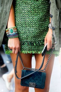 Green woven minidress + army jacket. High/low style. Chanel.