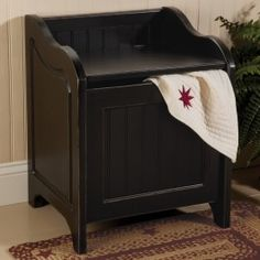 This bench doubles as a hamper. With any luck you will never see any loose clothes on the floor again.