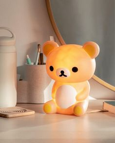 """Smoko x Rilakkuma brings you a cozy nightlight in the shape of Japan's most beloved teddy bear. Rilakkuma lights up orange, bringing warmth and comfort to any bedroom or office. split Details Rechargeable via USB (no batteries required). 100k hours. 6.3"""" x 4.6"""" x 7.5"""". Silicone. Night Light, Light Up, Rilakkuma, Teddy Bear, Ambient Light, Bedroom Inspo, Apartment Ideas, Taehyung, Room Ideas"""