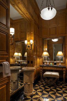 "Elegant Powder Room with ""column"" lavatory. Use of mirror and mood of room. Dressing vanity."