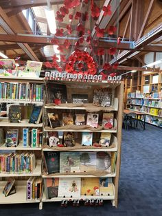 Display for Remembrance day, with help from students with the waterfall of Poppies. So many beautiful books on this topic for all ages. Remembrance Day, Liquor Cabinet, Poppies, Waterfall, Students, Display, Books, Furniture, Beautiful