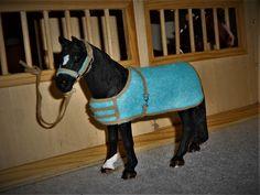 Schleich horse in stable.