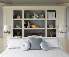Unusually carpentered bookcase headboard. I like the lights.