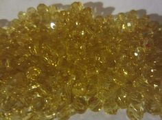Approximately 200 Golden Crystal Rondelles by InJamiesHands, $7.00
