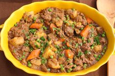 Guinness Beef Stew ~ Very little hands-on time, and then this stew will cook along, making your house smell wonderful! ~ from What a Girl Eats