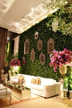 I love this wall for a backdrop - so chic with the mirrors hung within the greenery.