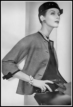 Anne St. Marie in a suit by Mainbocher, Vogue Dec. 1955