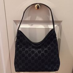 Guuci handbag Black suede with signature interlocking G's. Metal handle atop leather strap. Two separate sections with one interior zip pocket. Comes with dust bag. I'm trying to find the date code. VGUC. Please review all photos and ask any questions. Thank you!!  ⭐️ Gucci Bags Satchels