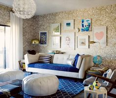 Personalize the space with a gallery wall or a collection of family photos and whimsical art. #FeatherYourNest