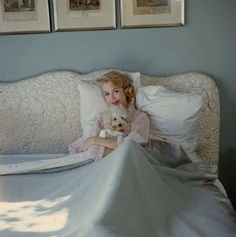 0 sandra dee holding her dog in her bed