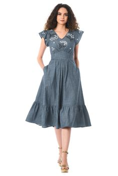 Ruched pleating adds flattering dimension to the flutter-sleeve bodice of our floral embellished cotton chambray dress finished with a ruffle flounce hem at the ruched pleat skirt.