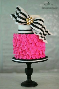 Unique Sweet 16 birthday cake idea.  Love the hot pink with black & white accent bow