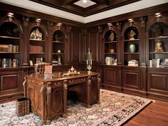 Traditional Home Office with Box ceiling, Built-in bookshelf, Hardwood floors, Crown molding