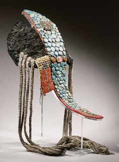 A Ladakh Female Headdres, Perak | Late 19th Century | The headdress consists of a central oblong panel decorated with a gahu box, surrounded by many rows of large turquoise beads, flanked to both sides by half-moon shaped fur panel, one with additional rectangular pendant set with rows of mother-of-pearl beads and red coral strings, both sides with each four twisted fibre strings | 2,350€ ~ Sold