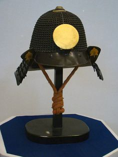 """64 Ken Ko-boshi Kabuto. A """"hoshi (in this case """"boshi)"""" refers to the raised rivet heads, that look like stars in the night sky. Although this helmet was made in the Edo Period (1603-1868), it harkens back to a an older and classic style of armor. As there really wasn't a need for practical battlefield armor during the Edo period, older armor styles became back in vogue, Takatsuki Castle Ruin Historical Museum in Takatsuki, Osaka. Samurai Helmet, Samurai Armor, Armature, Japanese Warrior, Edo Period, Cold Steel, Hoshi, Headgear, Osaka"""