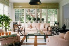 pink sofa, sunroom