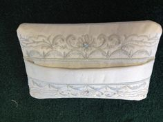 Travel Tissue Holder made using Vintage in the hoop accessories