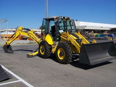 New Holland's backhoe has a max dig depth of 15 feet or 18 feet, 5 inches with the optional extended stick. It has a digging force of pounds. New Holland Agriculture, New Holland Ford, Specs, Don't Forget, Monster Trucks, Construction, Interior, Indoor, Interiors