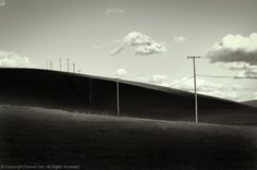 Shaded Hills, Poles, Clouds, Monochrome