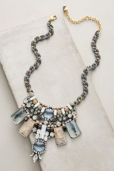 "Valeria Bib Necklace #anthropologie Boldly stated in sky blue, this bib necklace draws inspiration from NYC designer Lele Sadoughi's love for modern art and travel. 18k gold plating, resin, glass, brass, feather, zinc alloy, iron, rayon, cotton Lobster clasp Dimensions 16""L with 3"" extender chain 2.5"" bib"