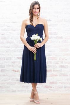 <ul>  <li>Layers+of+soft+tulle+make+this+strapless+tea+length+dress+special.
