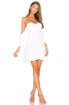 New NICHOLAS Flounce Mini Dress online. Enjoy the absolute best in Plush womens-clothing from clothing store. White Ruffle Dress, Ruffle Sleeve Dress, Short Sleeve Dresses, Australian Fashion Designers, Cool Summer Outfits, Revolve Clothing, Ladies Dress Design, Women's Fashion Dresses, Mini