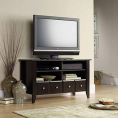 Add to the beauty and décor of your home with the Sauder Shoal Creek Panel TV Stand . Wonderfully crafted, this TV stand features two adjustable. Modern Home Furniture, Living Room Furniture, Office Furniture, Levin Furniture, Furniture Mattress, Reception Furniture, Dark Furniture, Furniture Shopping, Furniture Showroom