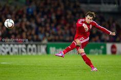 Gareth Bale takes a free kick against Cyprus.