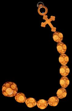 Boxwood rosary owned by Henry VIII. The cross has the four Evangelists on one side and the four Latin Church Fathers on the other. The Ave Maria beads have carvings depicting the Apostles, the sentences of the Creed, the Prophets, the Sibyls, and various scenes from Holy Writ. The Pater Noster bead is hinged, containing scenes of the Mass of St. Gregory and the Virgin in Majesty.
