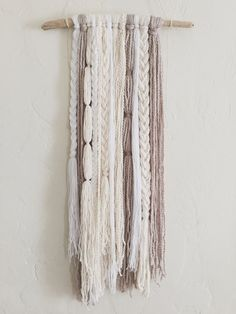 free form wall hanging featuring five different neutral fibers measures approx 33 in length for the larger size at its longest point approx 24