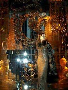 """Bergdorf Goodman Christmas window: """"Fire"""" That's a dragon behind her over the mirror."""