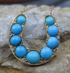 """Blue with Envy! Victorian natural cabochon turquoise 9 stone set with 16 tiny rose cut diamonds to create a lucky horseshoe that stands out from the crowd. A wonderful mix of 10k (horseshoe) and 14k (chain) yellow gold. 3/4"""" by 3/4"""" making it a piece that can't be missed when worn! Circa 1700 Jewelry """"Converted"""" Line"""