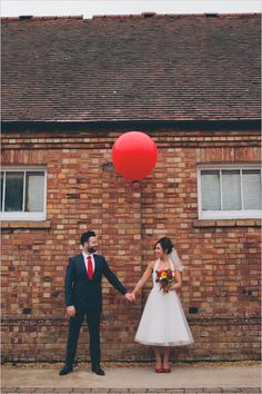 Here's a link to a sweet set of colorful wedding photos shot by London-based We Heart Photos. Everybody loves a red balloon, right?