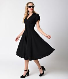 You gotta live in the moment, gals! A gorgeous vintage style dress from Hell Bunny, the Keely dress is 1950s rockabilly radiance incarnate. A woven textured swing, in a classic black midcentury V-neck silhouette, is charming with button up style and round