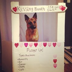 Kissing booth. All it takes is some cardboard, a little paint, toss in some paint chip hearts and voila! Adorable dog is a bonus.