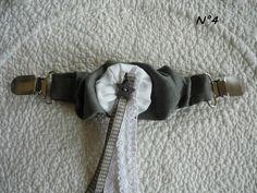pinces (pour resserrer une tunique ou remonter un jupon)