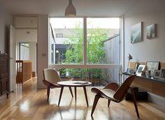 Hans Wegner CH07 Shell Chairs. Tim Crocker Photography - Amazing mid century interiors ... http://www.danishdesignstore.com/collections/hans-j-wegner-ch07-shell-chair