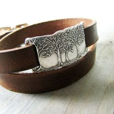 Inspired by the sense of peace that comes with a walk through the forest. Each link is recycled pure silver, pressed from my original carving. The silver link graces a double-wrap leather bracelet. Ive given the vegetable-tanned leather a warm brown color and finished with an all-natural conditioning balm.  The fine silver link is my own design and measures 1 3/8 x 5/8. The bracelet leather is 3/8 wide, with an unwrapped total length of 18. Doubled, it will adjust from 6 1&#x2F...