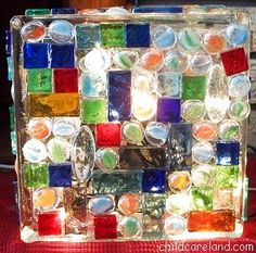 A glass block w/mosaic glass pieces adhered to the front and back. I imagine a few of them scattered around a yard would be beautiful on a hot summer night.