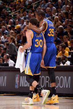 Kevin Durant and Stephen Curry of the Golden State Warriors talk during the game against the Utah Jazz during Game Four of the Western Conference...