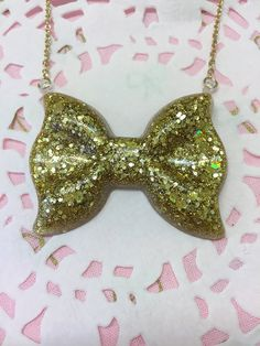 Sparkly Gold Bow Pendant Necklace by CandCBaby on Etsy