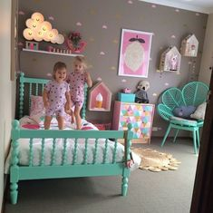 Cute turquoise bed and chair in this girls bedroom.