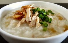 Bubur ayam is an Indonesian rice congee with shredded chicken served with condiments such as sliced spring onion and fried shallots.