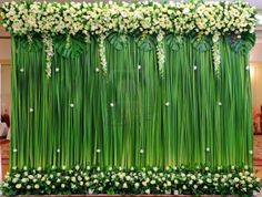 Green backdrop flowers arrangement for wedding ceremony  Stock Photo
