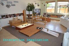 Like the idea of having building platforms of varying heights as well as incorporating the light table in the block building space.  | Boulder Journey School